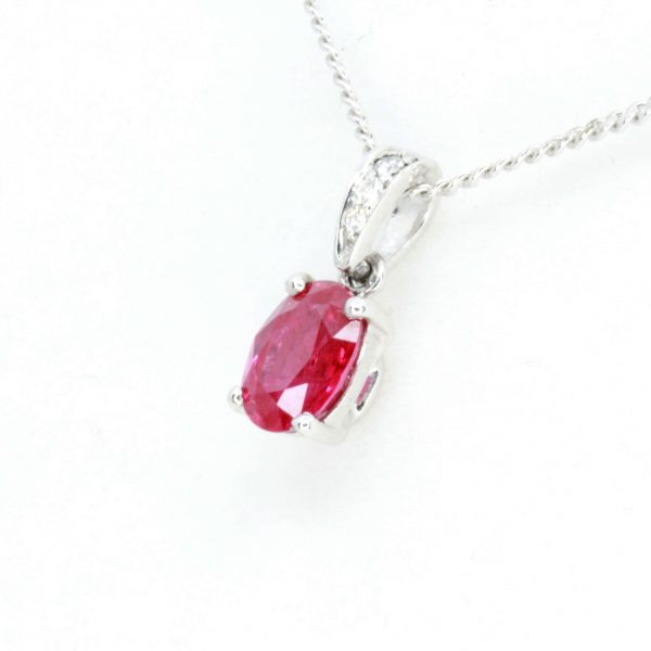 Oval Cut Ruby Pendant with Diamonds set in 18ct White Gold