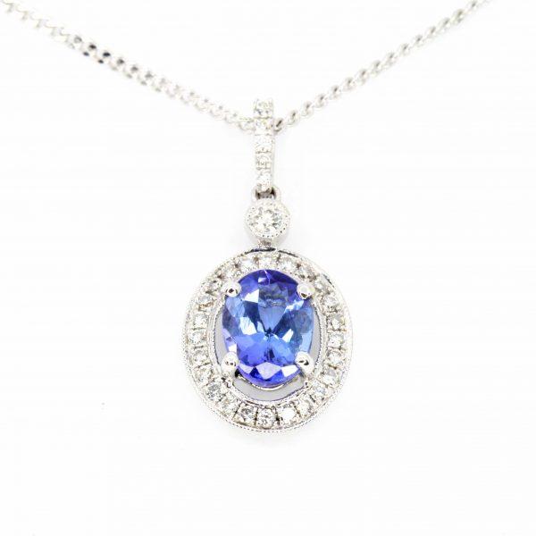 Oval Tanzanite Pendant with Halo of Diamonds set in 18ct White Gold