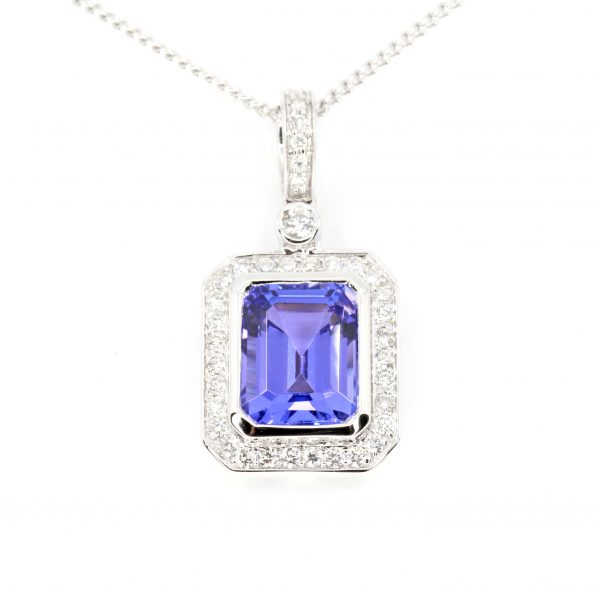 Emerald Cut Tanzanite Pendant with Halo of Diamonds set in 18ct White Gold