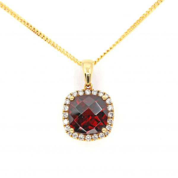 Checkered Cushion Garnet Pendant with Halo of Diamonds set in 18ct Yellow Gold