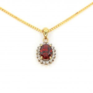 Oval Garnet Pendant with Halo of Diamonds set in 18ct Yellow Gold