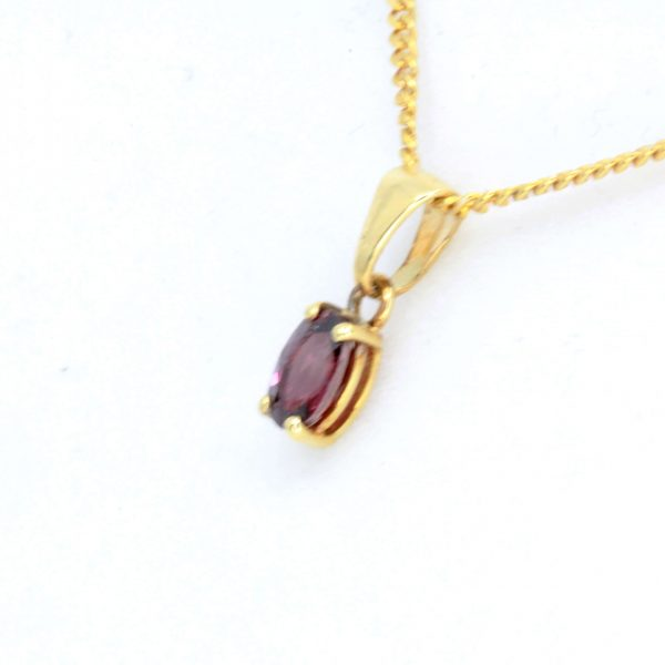 Oval Ruby Pendant set in 18ct Yellow Gold
