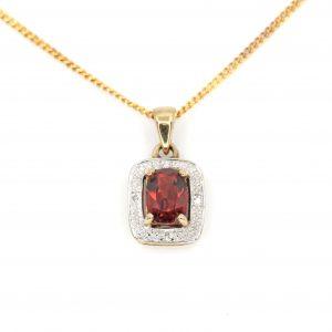 Garnet Pendant with Diamonds set in 9ct Yellow Gold