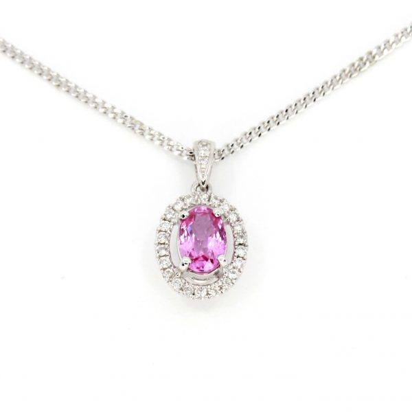 Oval Pink Sapphire Pendant with Halo of Diamonds set in 18ct White Gold