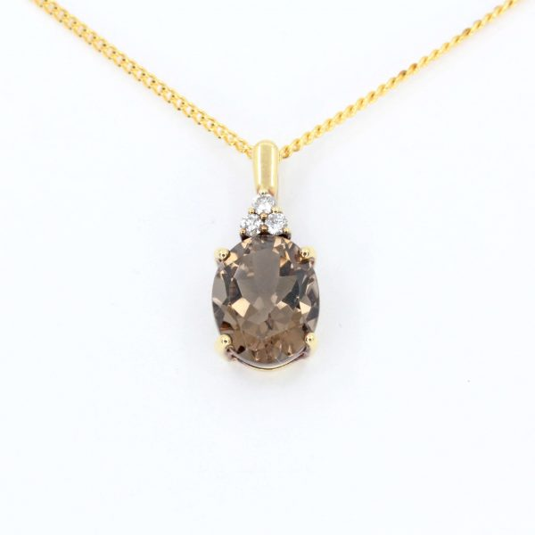 Oval Cut Smokey Quartz Pendant with Diamonds set in 18ct Yellow Gold