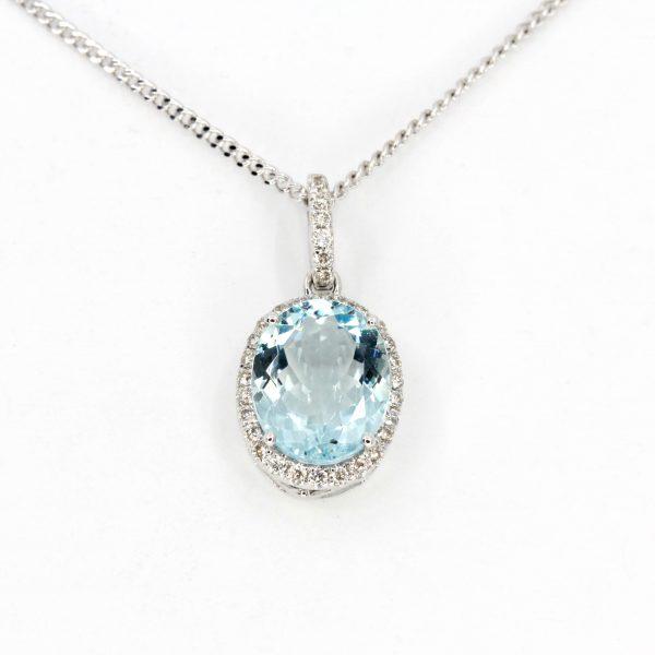 Oval Aquamarine Pendant with Halo of Diamonds set in 18ct White Gold
