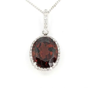 Oval Brown Tourmaline Pendant with Halo of Diamonds set in 18ct White Gold