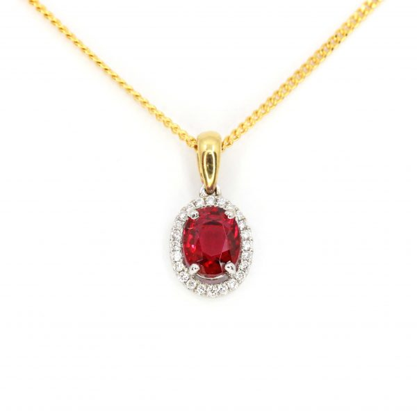 Oval Red Tourmaline Pendant with Halo of Diamonds set in 18ct White Gold & Yellow Gold