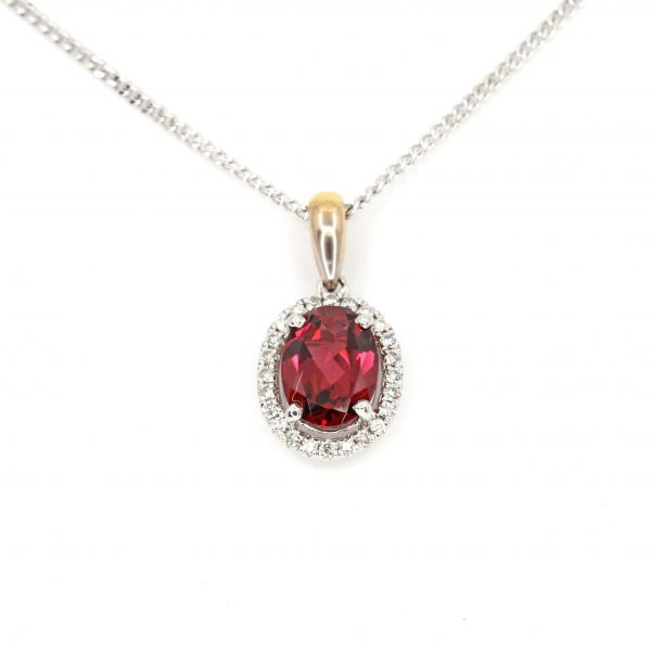 Oval Rhodolite Garnet Pendant with Halo of Diamonds set in 18ct White Gold & Yellow Gold