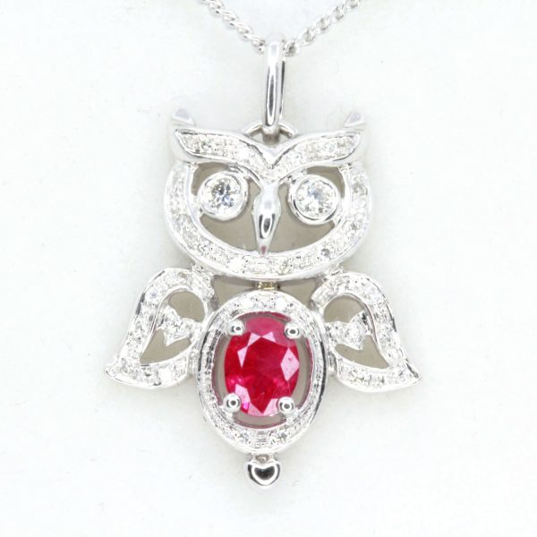 Oval Ruby Pendant with Halo of Diamonds set in 18ct White Gold