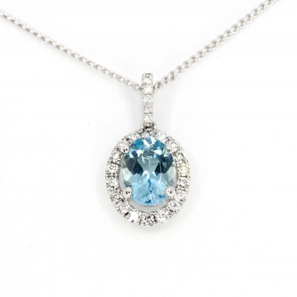 Oval Aquamarine Pendant with Halo of Diamonds set in 18ct White Gold
