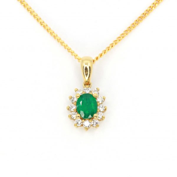 Oval Emerald Pendant with Halo of Diamonds set in 18ct Yellow Gold