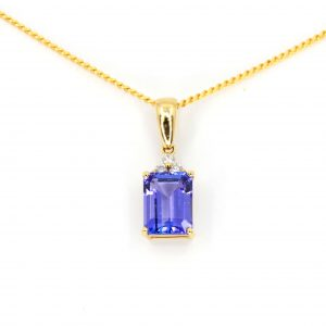 Emerald Cut Tanzanite Pendant with Diamonds set in 18ct Yellow Gold