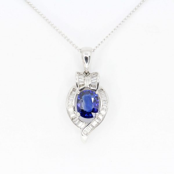 Oval Ceylon Sapphire Pendant with Halo of Diamonds set in 18ct White Gold