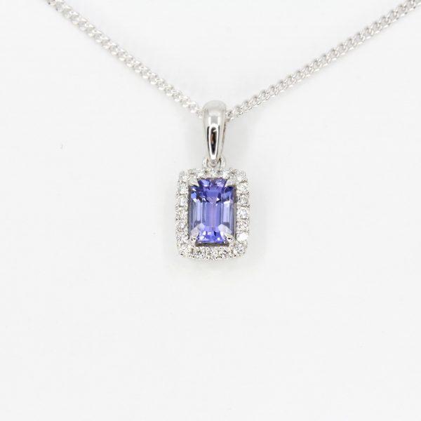 Emerald Cut Tanzanite Pendant with Halo of Diamonds set in 18ct White Gold