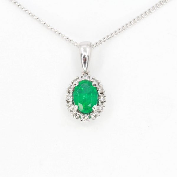 Oval Emerald Pendant with Halo of Diamonds set in 18ct White Gold