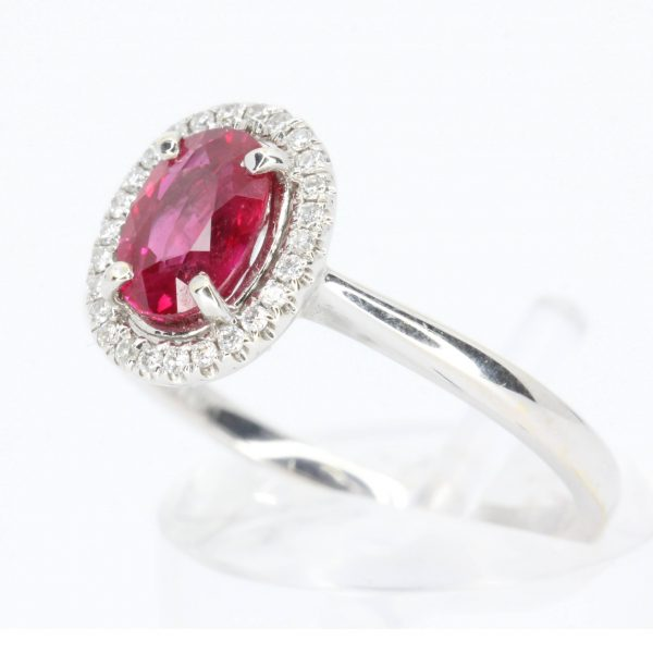 Oval Cut Ruby Ring with Diamond Halo Set in 18ct White Gold