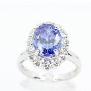 4.7ct Tanzanite Ring with 1.15ct Diamond Halo Set in 18ct White Gold