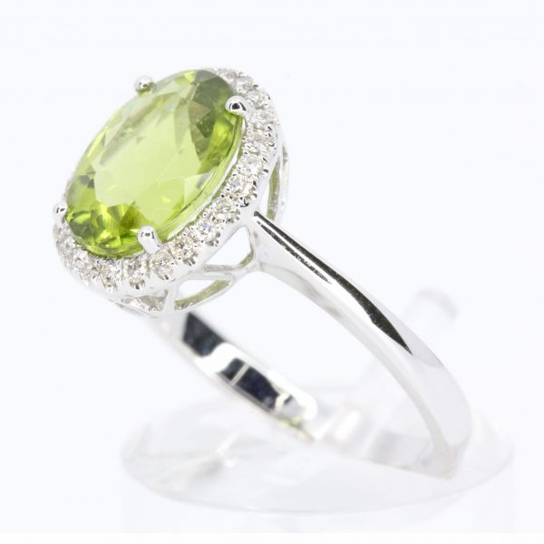 Oval Cut Peridot Ring with Diamond Halo Set In 18ct White Gold