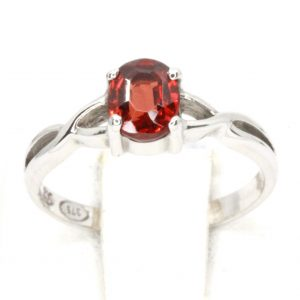 Garnet Solitaire Ring with Twisted Shoulders Set in 9ct White Gold