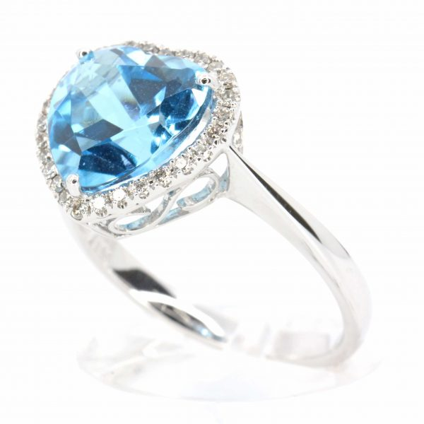 Heart Shape Blue Topaz Ring with Halo of Diamonds Set in 18ct White Gold