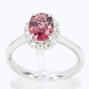 Oval Shape Pink Tourmaline Ring with Halo of Diamonds Set in 18ct White Gold