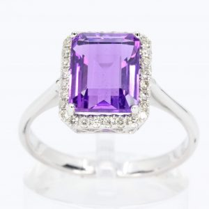 Emerald Cut Amethyst Ring with Halo of Diamonds Set in 18ct White Gold