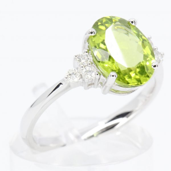 Oval Shape Peridot Ring with Accents of Diamonds Set in 18ct White Gold
