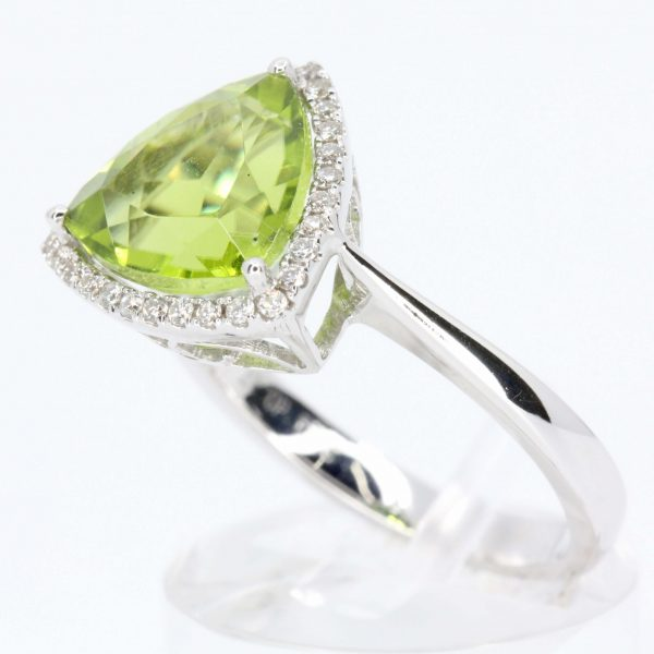 Trillion Cut Peridot Ring with Halo of Diamonds Set in 18ct White Gold