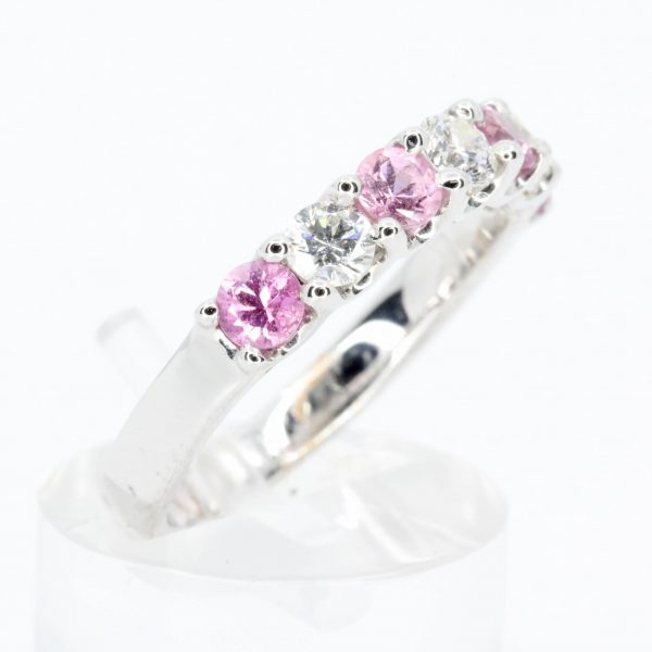 Round Cut Pink Sapphire Ring with Halo of Diamonds Set in 18ct White Gold
