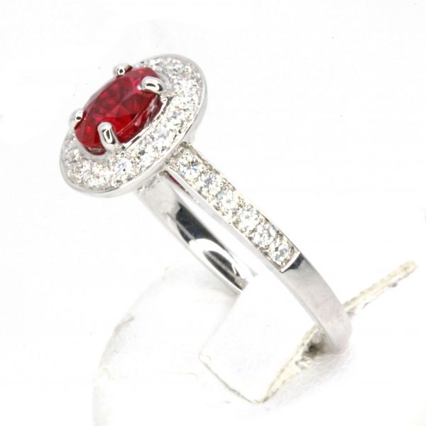 Oval Cut Ruby Ring with Accents of Diamonds Set in 18ct White Gold