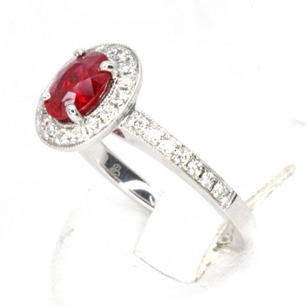 Oval Cut Ruby Ring with Migraine of Diamonds Set in 18ct White Gold