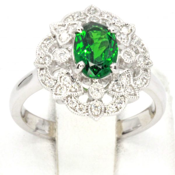 Oval Cut Tsavorite Ring with Halo of Diamonds Set in 18ct White Gold
