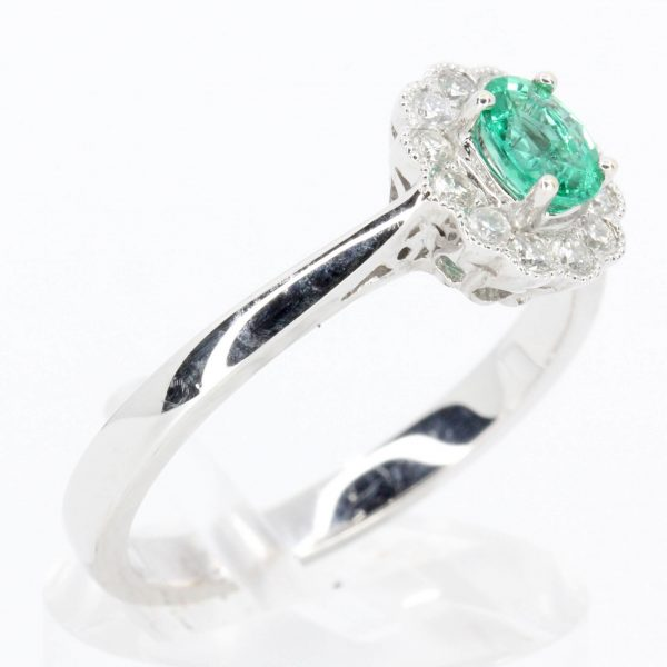 Oval Emerald Ring with Mil-grain Diamond Halo Set in 18ct White Gold