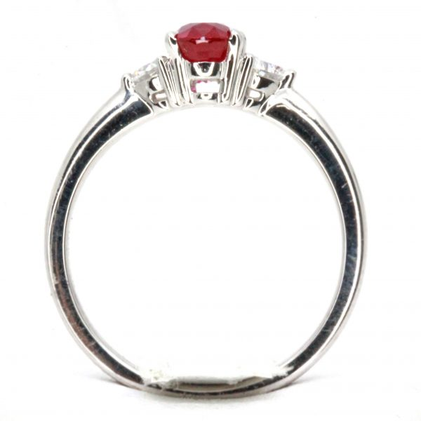 Oval Cut Ruby Ring with Heart Shape Diamonds Set in 18ct White Gold