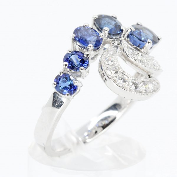 5 Oval Cut Sapphire Ring with Fancy Diamond Accents Set in 18ct White Gold