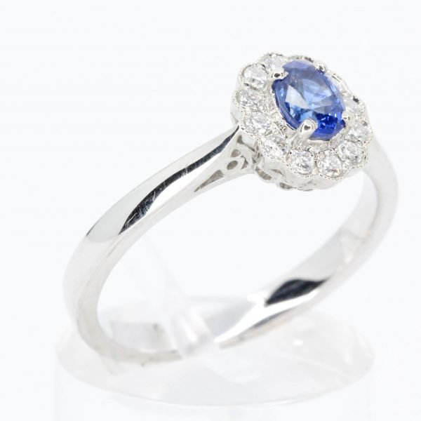Oval Shape Sapphire Ring with Diamond Halo Set in 18ct White Gold