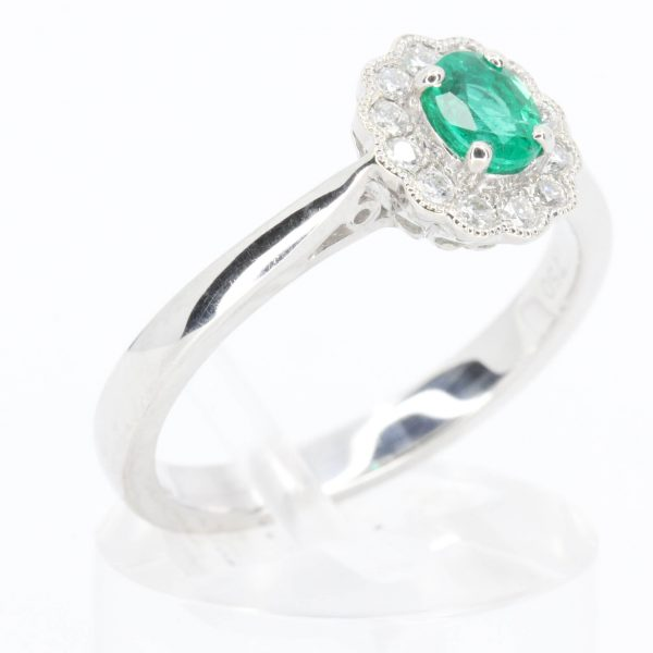 Oval Shape Emerald Ring with a Scallop Style Diamond Halo Set in 18ct White Gold