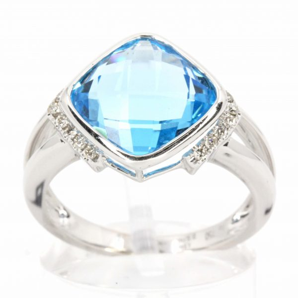 Cushion Cut Blue Topaz Ring with Accents of Diamonds Set in 18ct White Gold