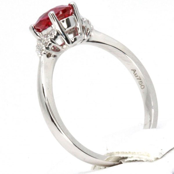 Oval Shape Ruby Ring with Accents of Diamonds Set in 18ct White Gold