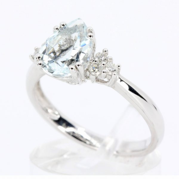 Pear Cut Aquamarine Ring with Accents of Diamonds Set in 18ct White Gold