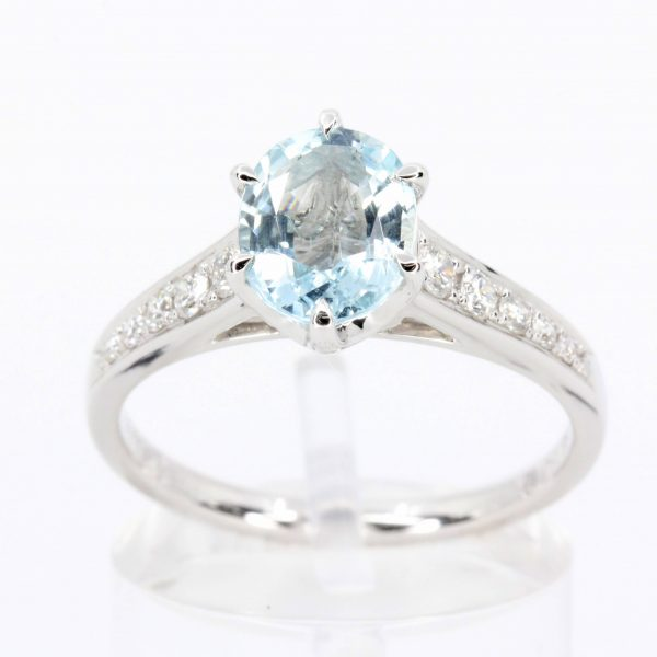 Oval Shape Aquamarine Ring with Accents of Diamonds Set in 18ct White Gold