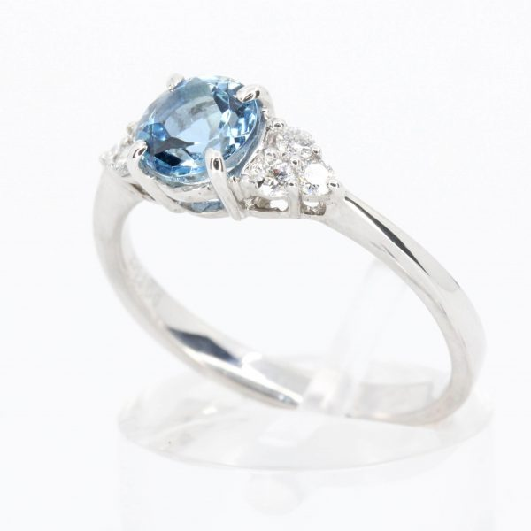 Round Cut Aquamarine Ring with Accents of Diamonds Set in 18ct White Gold