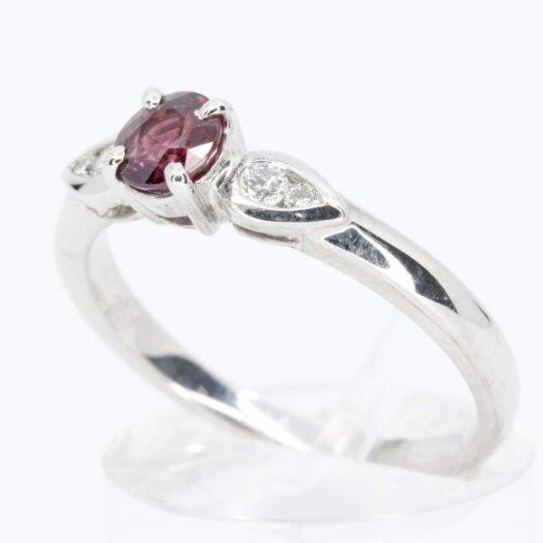Round Cut Ruby Ring with Accents of Diamonds Set in 18ct White Gold