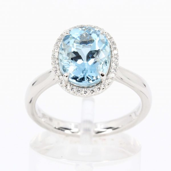 Oval Shape Aquamarine Ring with Halo of Diamonds Set in 18ct White Gold
