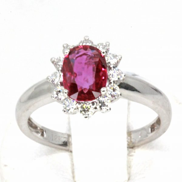 Oval Shape Ruby Ring with Halo of Diamonds Set in 18ct White Gold