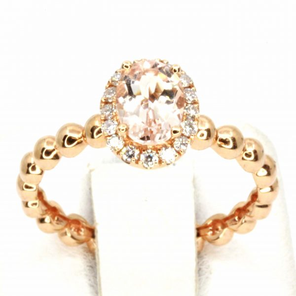 Morganite Ring with Halo of Diamonds Set in 18ct Rose Gold