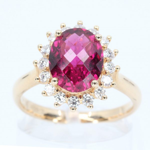 Oval Shape Pink Tourmaline Ring with Halo of Diamonds Set in 18ct Rose Gold