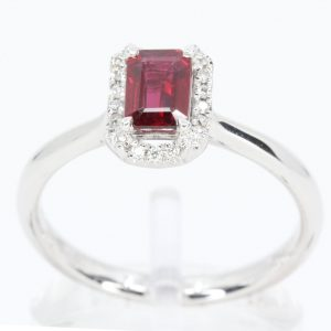 Emerald Cut Ruby Ring with Halo of Diamonds Set in 18ct White Gold