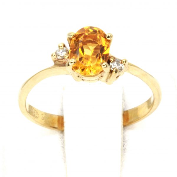 Oval Shape Citrine Ring with Accents of Diamonds Set in 9ct Yellow Gold